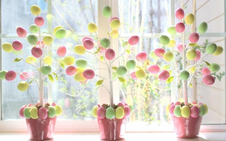 images de pâques arbres décoré oeufs tons pastel